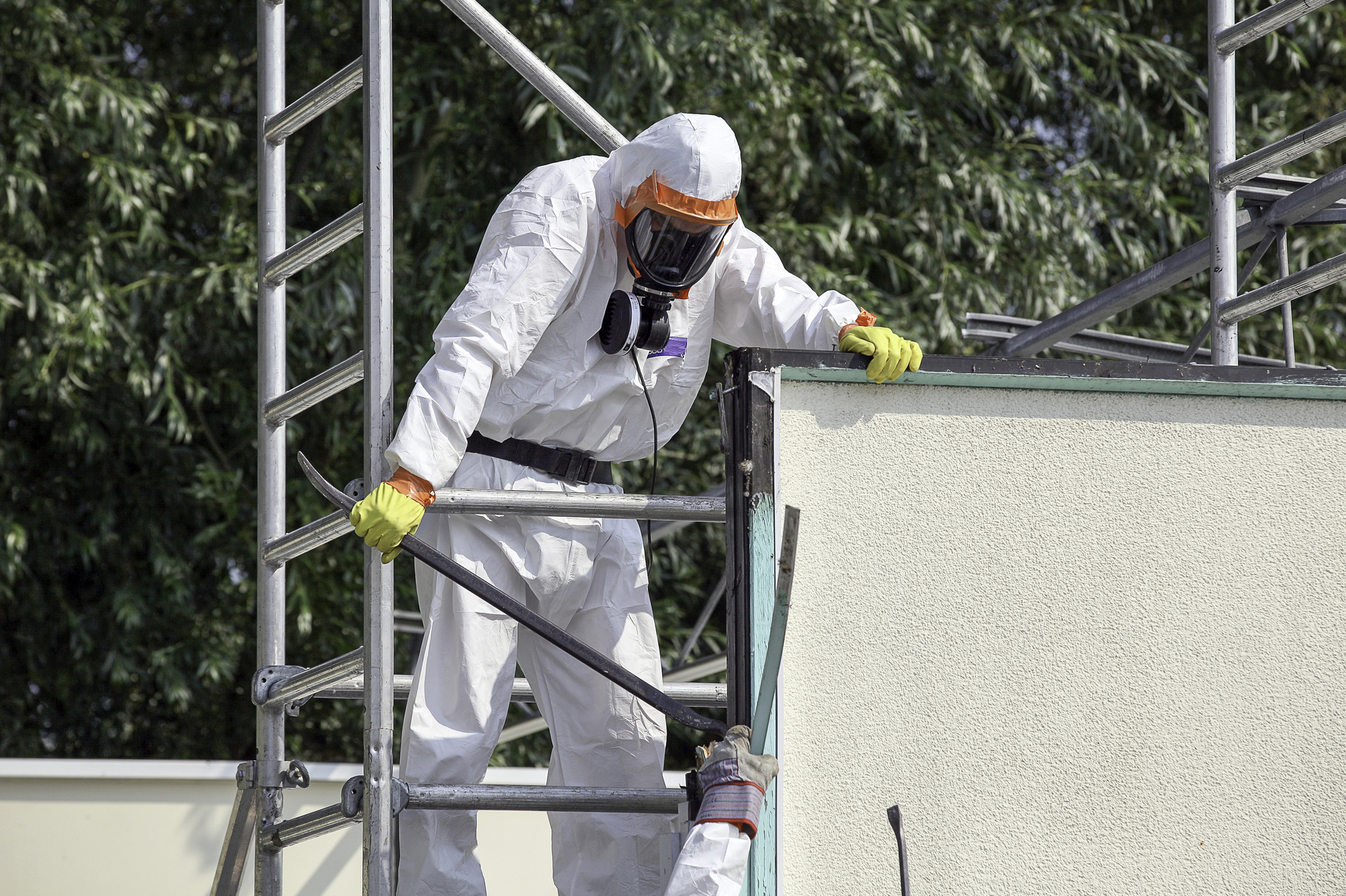 A worker on an asbestos removal site